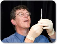 Ian Frazer Prepares to administer a vaccine